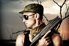 Handsome dangerous military man Stock Photo