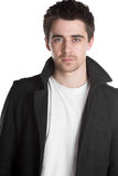 Handsome Dark Haired Male in Jacket. Isolated Shot of a Handsome Dark Haired Male in Jacket Royalty Free Stock Images
