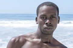 Handsome dark summer beach stud Stock Images
