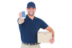 Handsome delivery man showing mobile phone Stock Image