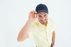 Handsome delivery man wearing baseball cap Royalty Free Stock Image