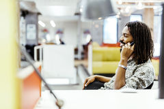 Handsome designer smiling while working in an office Stock Photo