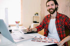 Handsome designer working at his desk Stock Photography