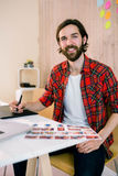 Handsome designer working at his desk Royalty Free Stock Photo