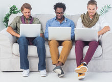 Handsome designers working with laptops Royalty Free Stock Photo