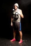 Handsome determined young boxer Royalty Free Stock Images