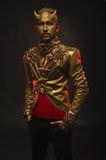 Handsome devil man with golden horns. And ornamental jacket Stock Photo
