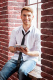 Handsome with digital tablet. Royalty Free Stock Images