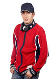 Handsome disc jockey. Disc jockey with headphones on white background royalty free stock photography
