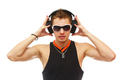 Handsome DJ in sunglasses and headphones Stock Photography