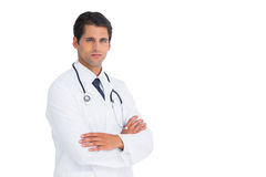 Handsome doctor with arms crossed Royalty Free Stock Image