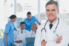 Handsome doctor with arms folded Stock Photos