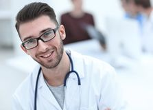 Handsome doctor on blurred background. Closeup.portrait of a handsome doctor on blurred background .photo with copy space stock images