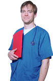 Handsome doctor holding folder Royalty Free Stock Images