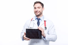 Handsome doctor holding the laptop Royalty Free Stock Photos