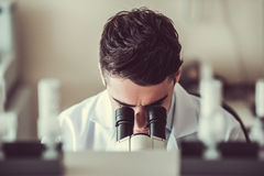 Handsome doctor in laboratory Stock Images