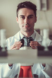 Handsome doctor in laboratory Royalty Free Stock Photography