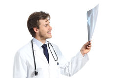Handsome doctor man examining a radiography. Isolated on a white background Stock Image