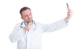 Handsome doctor or medic taking a selfie Stock Photography