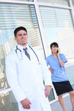 Handsome Doctor Outside Hospital Stock Photography