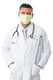 Handsome doctor portrait with a white coat, face mask Stock Photos