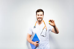Handsome doctor showing pills Royalty Free Stock Photos