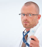 Handsome Doctor standing beside copy space Royalty Free Stock Images
