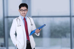 Handsome doctor standing near the window Royalty Free Stock Image