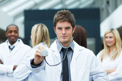 Handsome doctor with stethoscope Stock Image