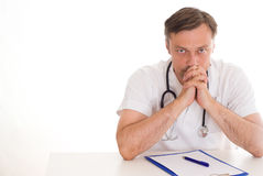 Handsome doctor on a white Stock Photography