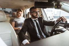 handsome driver and attractive businesswoman stock images