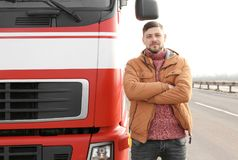 Handsome driver near big modern truck Royalty Free Stock Photography