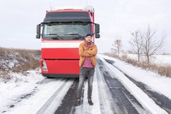 Handsome driver near big modern truck Royalty Free Stock Images