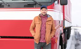 Handsome driver near big modern truck. Outdoors Royalty Free Stock Images