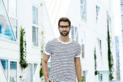 Handsome dude in striped t-shirt. Portrait royalty free stock photography