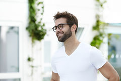 Handsome dude in white t-shirt and glasses. Smiling Stock Photos