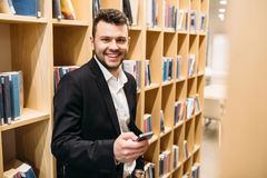Handsome dusinessman, work,contact, seif-education in office Royalty Free Stock Photo