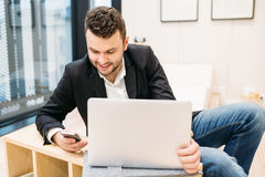 Handsome dusinessman, work,contact, seif-education in office Stock Image