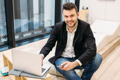 Handsome dusinessman, work,contact, seif-education in office Stock Photos
