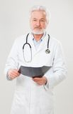 Handsome elderly doctor with radiograph Stock Photography