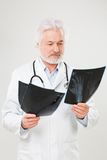 Handsome elderly doctor with radiograph Stock Images