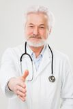 Handsome elderly doctor in uniform Royalty Free Stock Photo