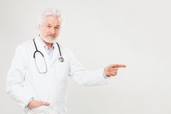 Handsome elderly doctor in uniform Royalty Free Stock Photos