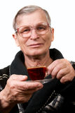 Handsome elderly man drinking coffee Stock Photos