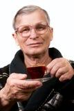 Handsome elderly man drinking coffee Stock Photos
