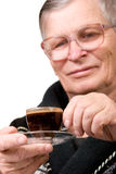 Handsome elderly man drinking coffee Stock Photography