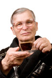Handsome elderly man drinking coffee. Isolated Royalty Free Stock Photos