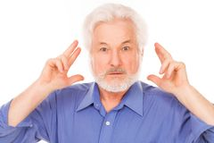 Handsome elderly man has an idea Royalty Free Stock Photos