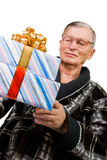 Handsome elderly man holding gift boxes Stock Photography