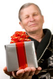 Handsome elderly man holding gift boxes Royalty Free Stock Images